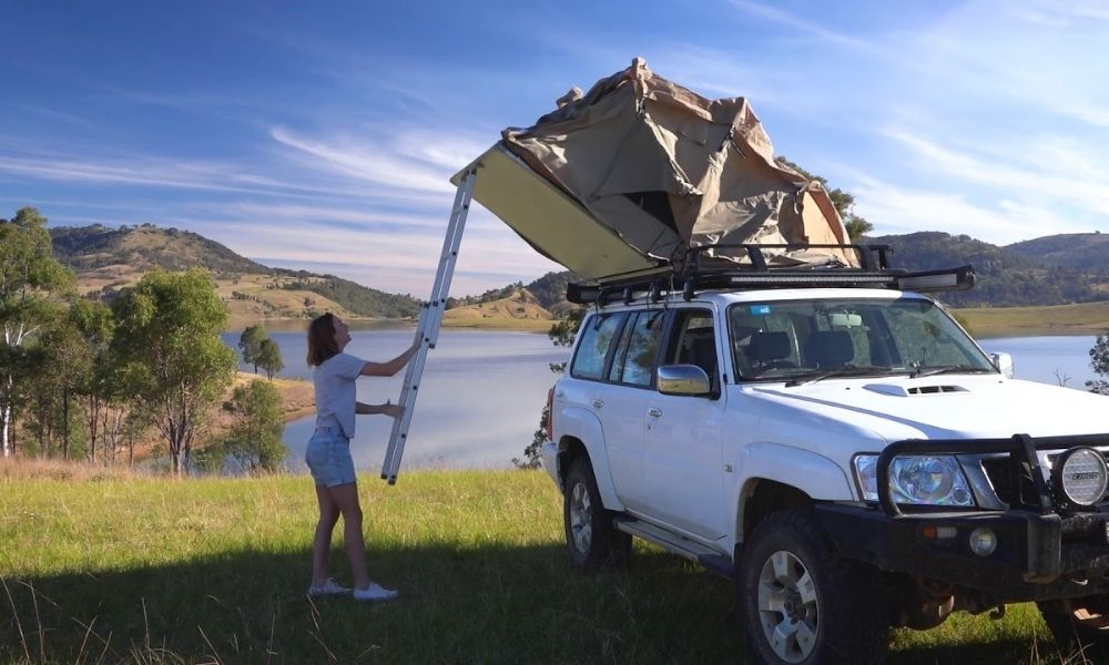 person showing you how to set up your rooftop tent