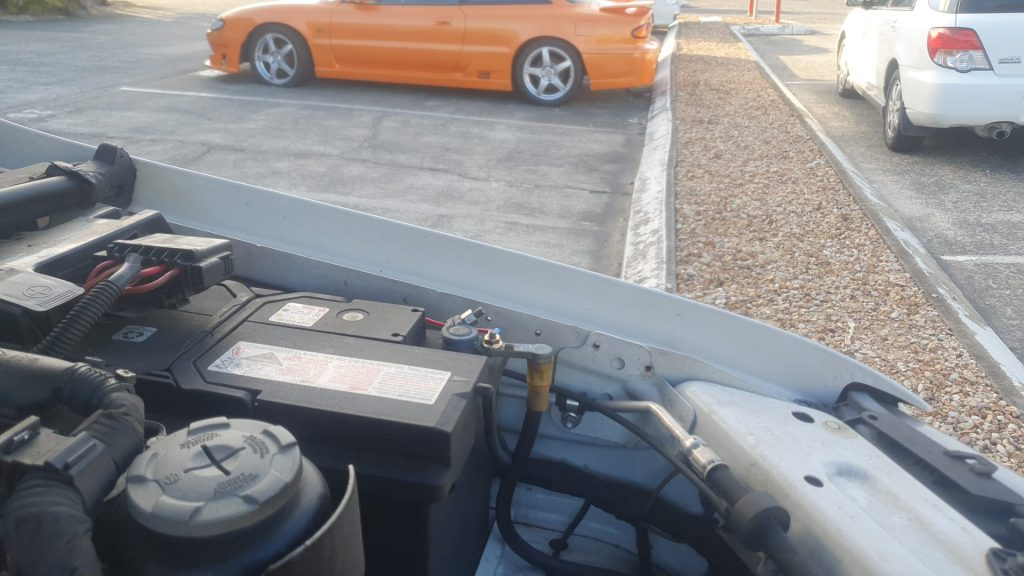 find the battery in your car bonnet