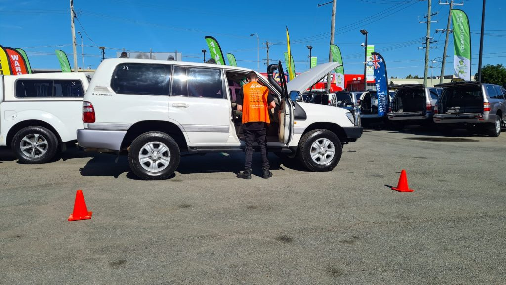 one of our queensland inspectors carrying out a pre purchase car inspection at a car dealership