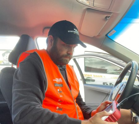 queensland car examiners carrying out a computer diagnosis to ensure the computer of the vehicle is working well.
